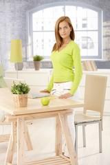 Portrait of attractive woman in living room