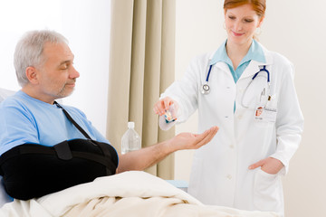 Hospital - female doctor give pill patient