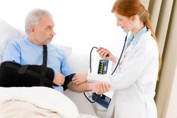 Hospital - doctor measure blood pressure patient