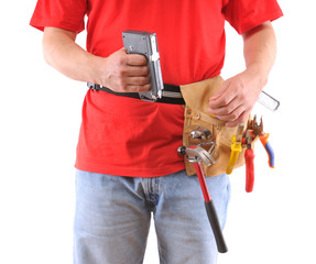 Construction worker with tool belt over white background.