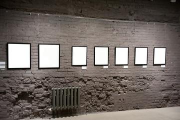 Empty frames on the brick wall