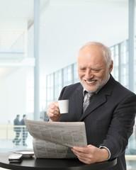 Senior businessman on coffee break