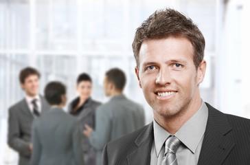 Smart businessman smiling