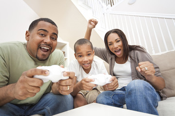 African American Family Having Fun Playing Computer Console Game