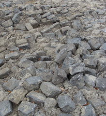 total destruction  wavy cobble-stone road
