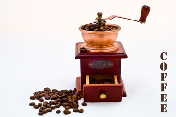 old mill and coffee beans