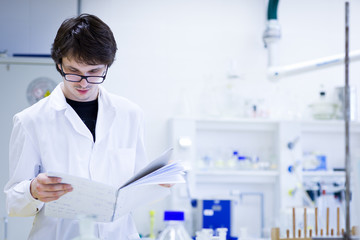young male researcher carrying out scientific research