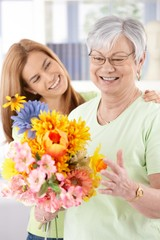 Elderly woman and daughter smiling happily