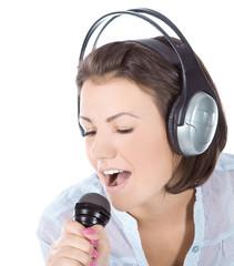 Caucasian female singing into microphone.