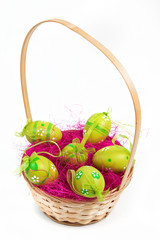 Wood bascket with green Easter eggs