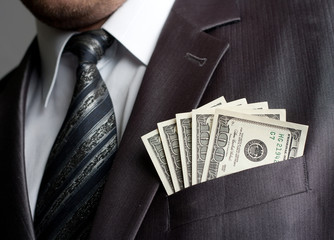 Fotobehang - Businessman with money in suit pocket