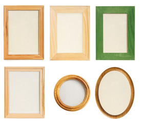 many different wooden photo frames isolated