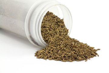 Caraway seeds spilling from container