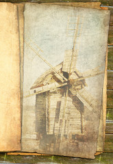 Grungy windmill in sepia