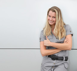 Smiling blond woman on grey background