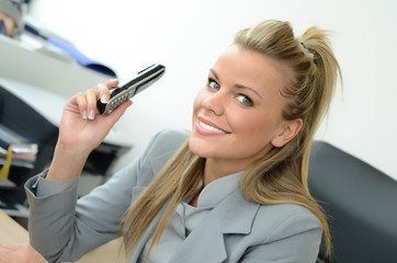 Beautiful businesswoman with phone