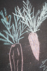 A detail of a child's colourful chalk picture on the pavement