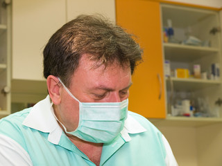 Experienced dentist working in the mask