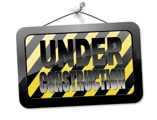 Hanging under construction sign