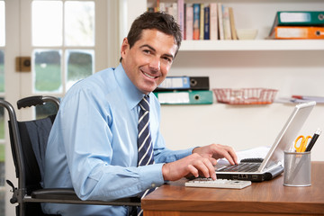 Man Working From Home Using Laptop