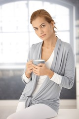 Portrait of pretty woman with tea mug