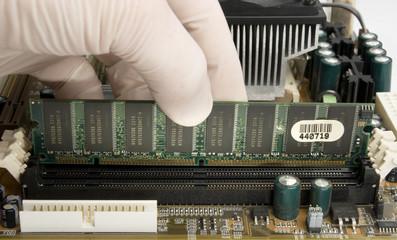 installing RAM memory into motherboard
