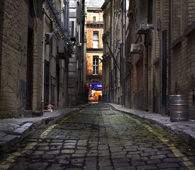Acrylic Prints Narrow alley Looking down a long dark back alley