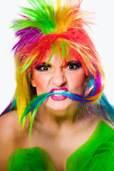 woman wearing multicolored wig looking aggressively
