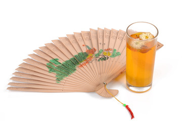 chinese tea and hand fan