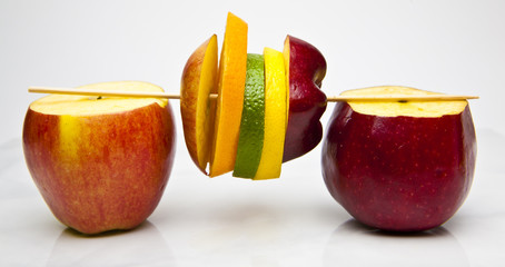 kebob of various fruit slices