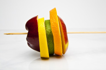 apples, lemon, orange, lime slices on skewer