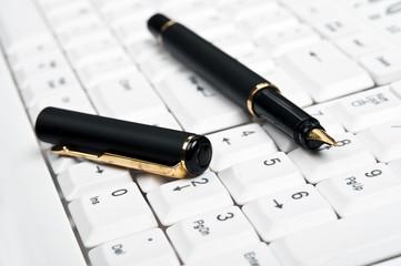 Pen on keyboard
