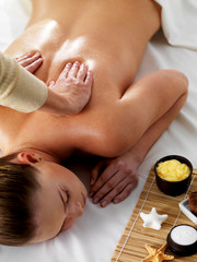 Relaxation and joy in spa massage on back