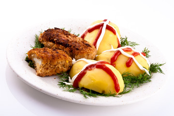 Potatoes with cutlets and salad on the plate