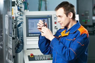 worker examining detail