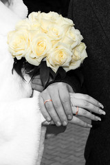 Wedding bouquet & hands with rings