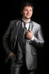 attractive man in the silver business suit
