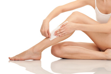 depilation legs with waxing and tape