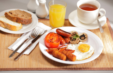 Delicious full breakfast on table
