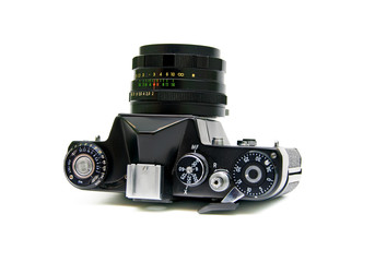 old analog SLR camera closeup on white background