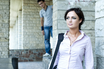 photo of business woman and a guy in torn jeans