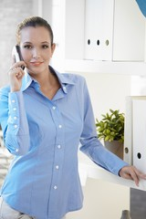 Portrait of office worker on phone call