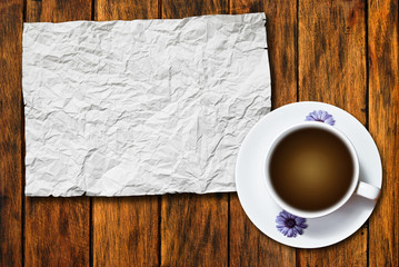 crumpled paper with coffee on wood background