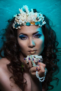 Mermaid with crown of corals