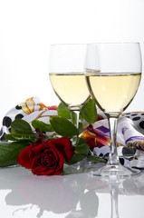 Glasses of wine and a flower