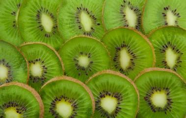 Kiwi slices forming background