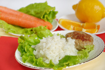 Home cooking, cutlet with rice and vegetables