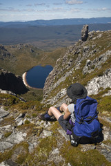 Backpacker looking down at Lake Rhona, Tasmania, Australia.