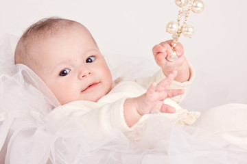 bright closeup portrait of adorable baby with toy
