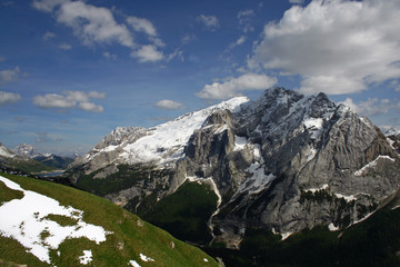 Marmolada glacier covered with dirty snow in the Alps